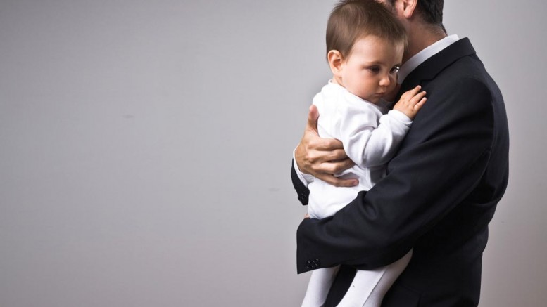 stock-photo-6538700-man-wearing-suit-holding-a-baby-2