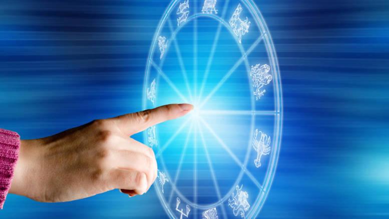 female hand touching a zodiac chart