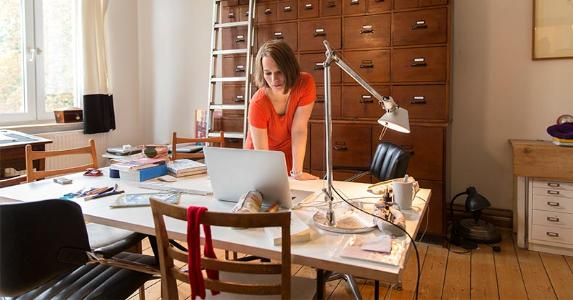 woman-working-in-home-office-file-cabinet-getty_573x300