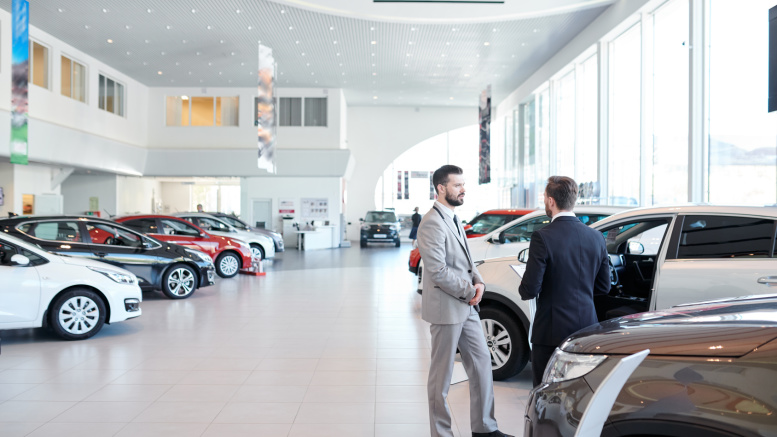 People in auto showroom